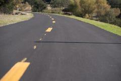 Fahrrad und Gehweg Stockbilder