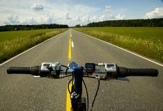 Fahrrad und Straße Lizenzfreie Stockbilder