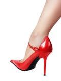 Fahrwerkbein im roten Schuh Lizenzfreie Stockfotos