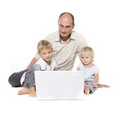 Fahter and two kids with laptop Stock Photo