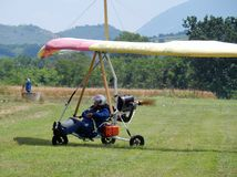 Hang-glider landed. Faicchio, Campania, Italy - 10 June 2018: Engine hang-glider just landed in Macchia on the occasion of the first edition of the `1st Meeting stock photo