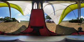 360 overview of a powered hang glider. Faicchio, Campania, Italy - 10 June 2018: Spherical photo of a two-seater hang glider on display at Macchia on the stock photography