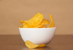 Faience bowl with chips against paper Stock Photography