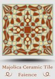 Faience ceramic tile in beige, olive green and red terracotta. Vintage ceramic majolica. Traditional glaze pottery. Product with multicolored symmetric spanish Stock Photography