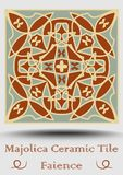 Faience ceramic tile in beige, olive green and red terracotta. Vintage ceramic majolica. Traditional spanish pottery product with. Multicolored geometric Royalty Free Stock Images