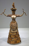 Faience figurine of the Snake Goddess Royalty Free Stock Photo