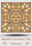 Faience pottery tile in beige, olive green and red terracotta. Multicolored ceramic majolica. Vintage spanish pottery. Product with multicolored symmetric Stock Photography