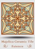 Faience pottery tile in beige, olive green and red terracotta. Vintage ceramic majolica. Traditional spanish pottery product with. Multicolored symmetric Royalty Free Stock Photo