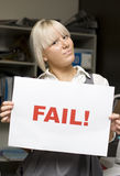 Fail. To You Says The Sign An Corporate Woman Holds Up In An Office Print Room Royalty Free Stock Photo