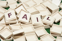Fail. Scrabble letters on green background Royalty Free Stock Photography
