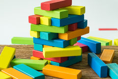 Fail and collapse colorful wooden block tower in as Risk or stab Royalty Free Stock Photos