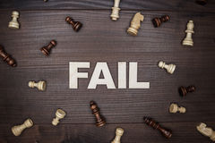 Fail concept on wooden background. Fail concept on the brown wooden background royalty free stock image