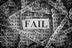 Torn pieces of paper with the words Fail stock photography