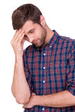 Failed again. Frustrated young man in casual shirt touching his forehead with hand and keeping eyes closed while standing isolated on white Royalty Free Stock Photography