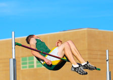 Failed attempt. High jumper just missing making it over the bar Stock Image