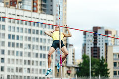 failed attempt at pole vaulting male athlete stock images