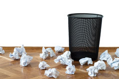 Failed attempts. Hopelessly unsuccessful attempts, wastepaper bin with lots of paper balls on the floor none inside Royalty Free Stock Photography