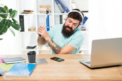 Failed mobile negotiations. Most annoying thing about work in call center. Incoming call. Annoying client calling. Man. Bearded guy headphones office swing stock image