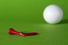 Failure. Broken tee and golfball, grass-green background stock photo