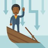 Failure black businessman standing on a sinking Stock Image