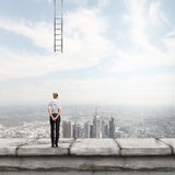 Failure in business. Rear view of businesswoman looking at broken ladder Royalty Free Stock Photos