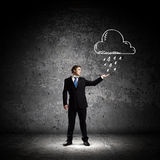 Failure in business. Young businessman under raining sky. Failure concept Stock Photography
