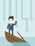 Failure chinese businessman standing on a sinking Stock Images