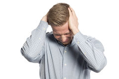Miserable businessman with hands at head showing grief. Royalty Free Stock Photography