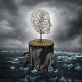 Failure Crisis. Concept and lost business career or education opportunity metaphor as a dying tree shaped as a human head alone on a rock cliff with dry ground Stock Images