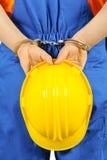 Failure guilty laborer regretful criminal handcuffed hard hat blue collar portrait Stock Images