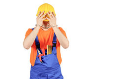 Failure guilty laborer regretful criminal handcuffed hard hat blue collar portrait on white Stock Images