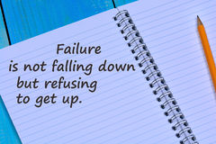Failure is not falling down but refusing to get up text on notebook Royalty Free Stock Photos
