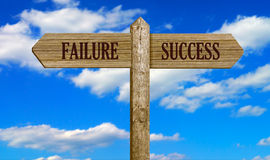 Failure & succes. A sign with arrows pointing to directions to failure and success Stock Images
