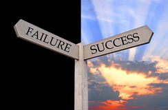 Failure or success direction sign Stock Photos