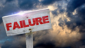 Failure. Text on a wooden sign and dramatic sky Stock Images