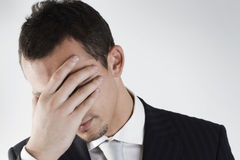 Failure of a young businessman. That try to close his face Stock Images