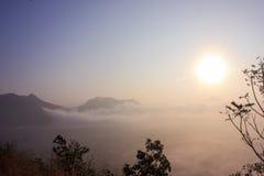 Faint mist. Sun shining over a faint sea mist and mountain Royalty Free Stock Photo