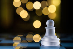 Faint Pawn On Blue Chessboard With Bokeh Royalty Free Stock Photos