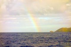 A faint rainbow the caribbean Stock Photo