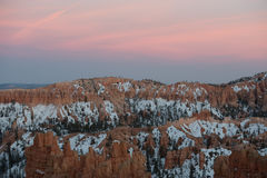 Faint Sunset Begins Over Snowy Bryce. Canyon Royalty Free Stock Image