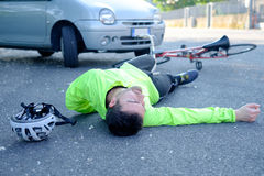 Fainted aching man after bicycle accident Stock Images