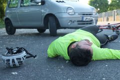Fainted man after bicycle accident. Fainted aching man after bicycle accident on the asphalt Royalty Free Stock Photos