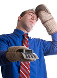 Fainting Banker. A young banker is fainting at the calculations he did on his calculator Royalty Free Stock Images