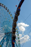 At The Fair. Ferris Wheel and an Over-The-Top Speed Ride Stock Photography
