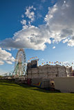 At the fair. View of a fair with ferris wheel and an attractive clouded sky Royalty Free Stock Photography
