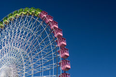 In the fair. Ferris wheel isolated on blue, working in the fair of Albacete Royalty Free Stock Photo