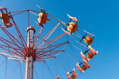 Fair attraction. Mechanical swing on a fair Royalty Free Stock Image