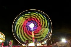 Fair carnival ferry wheel in speed. A carnival night view in a town Royalty Free Stock Image