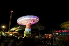 Fair carnival ferry wheel in speed Stock Photos