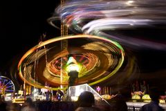 Fair carnival ferry wheel in speed Stock Images